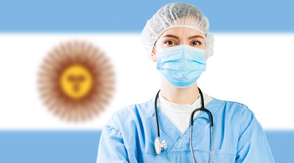 Retrato de um médico caucasiano com a bandeira da Argentina ao fundo, crise da doença do vírus COVID-19, pandemia mundial mundial de Coronavirus, isolamento de distanciamento social e conceito de quarentena