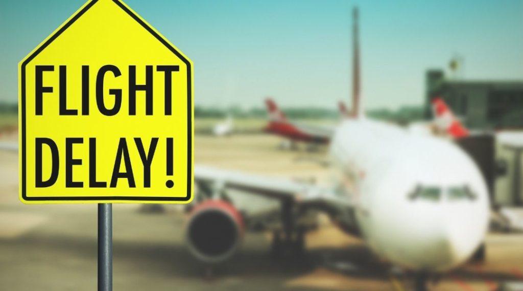 Sinal de trânsito de atraso de voo no aeroporto